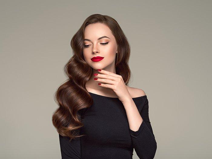 Portrait of a model wearing a red lipstick.