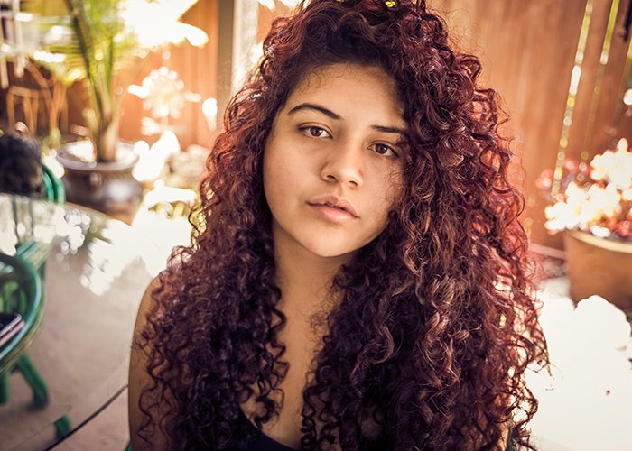 Self-portrait of a woman with curly hair