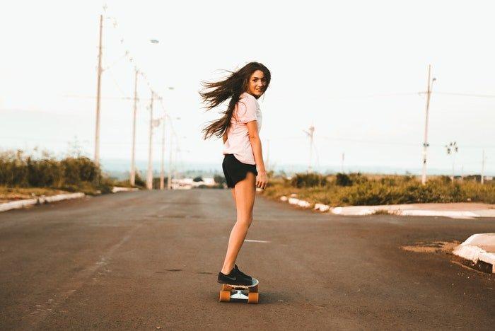 Stock photo of a girl on a skateboard