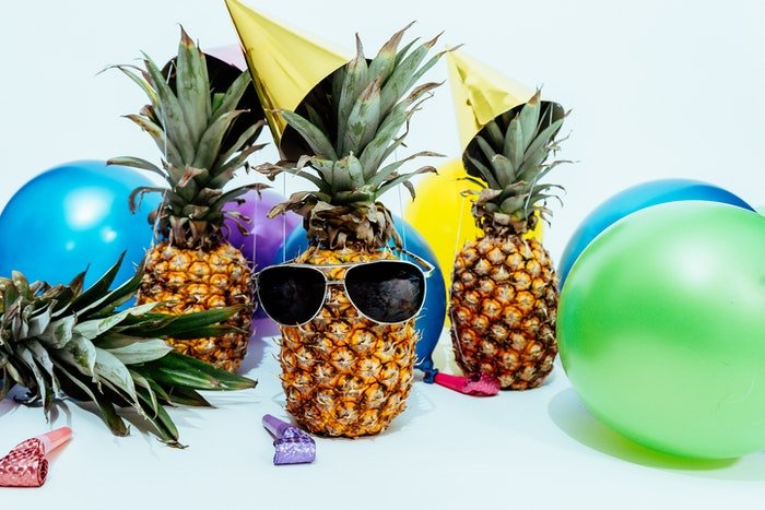 Funky photo of pineapples in sunglasses