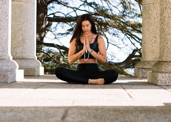 A girl in a yoga pose outdoors