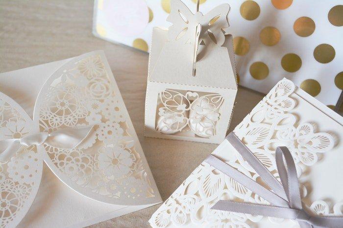 A still life of white wedding stationary