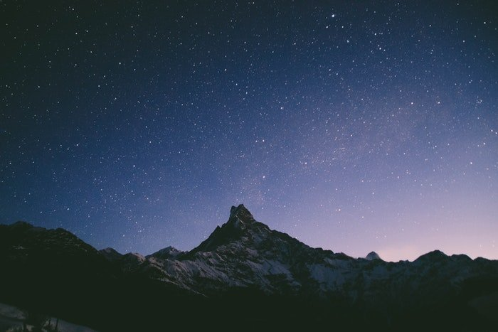 Impressive starry sky over a rocky landscape