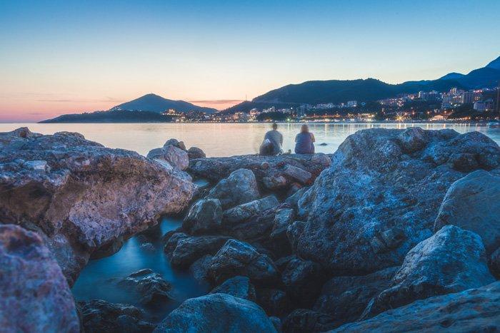 A rocky coastal scene at evening time