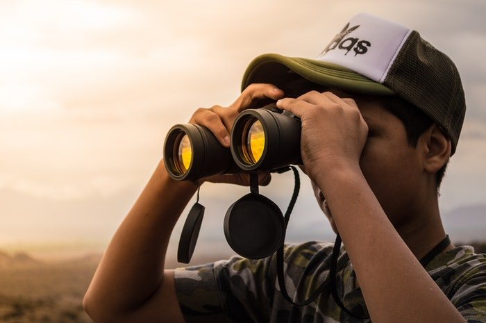 Man holding a pair of binoculars