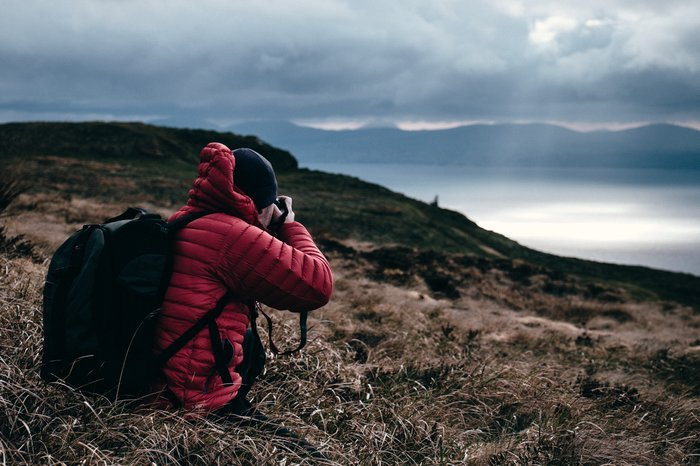 A man taking a landscape photo