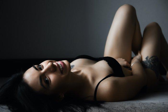 DIY boudoir shot of a girl lying on a bed