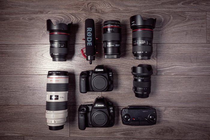 A range of photography equipment laid out on a table