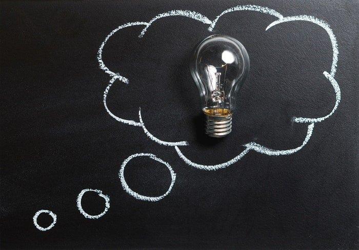 A lightbulb on a chalk board
