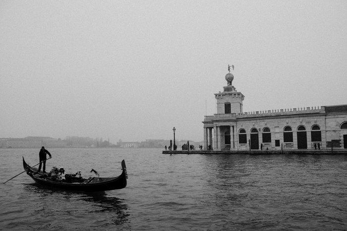 Black and white image of a gondola in Venice