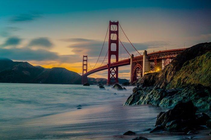A bridge over a coastal scene