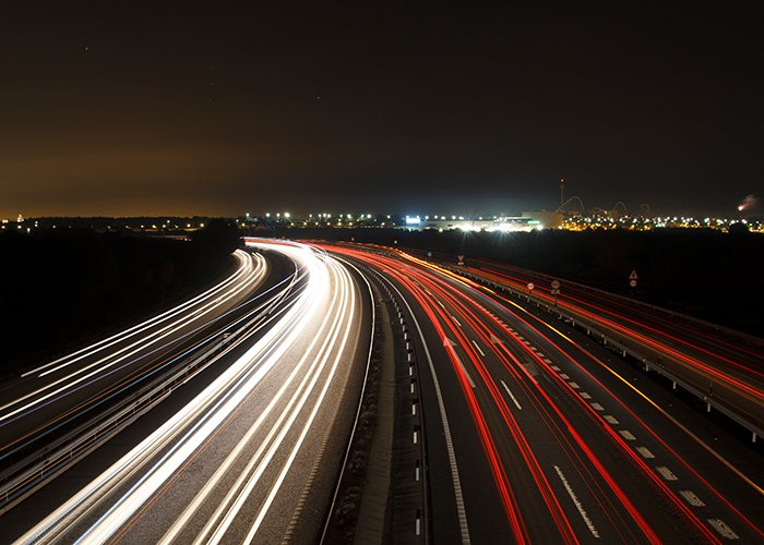 Long exposure night photography with traffic lights in the road