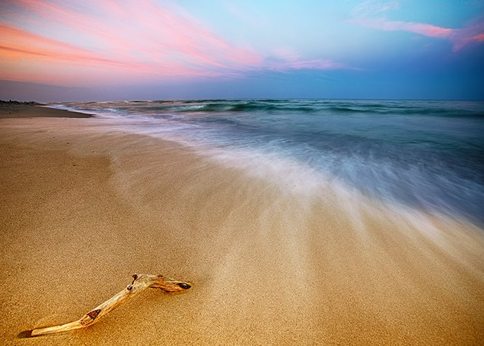 Magnificent long exposure landscape photography of sea sunset.
