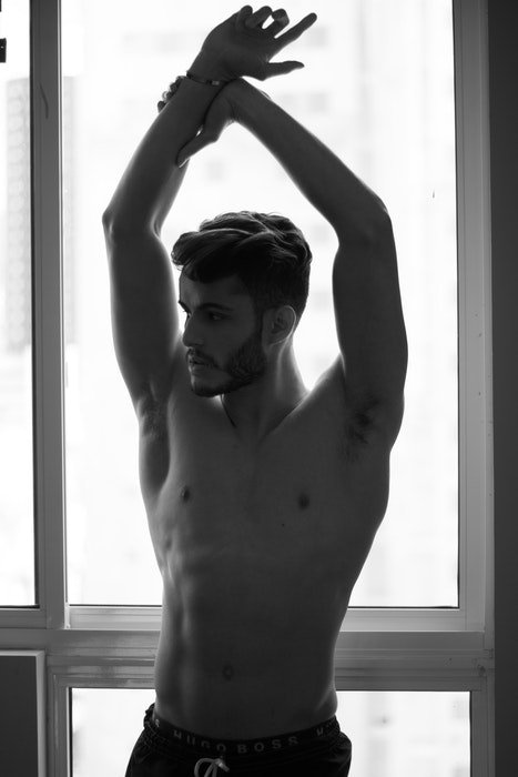Black and white photo of a half naked male model