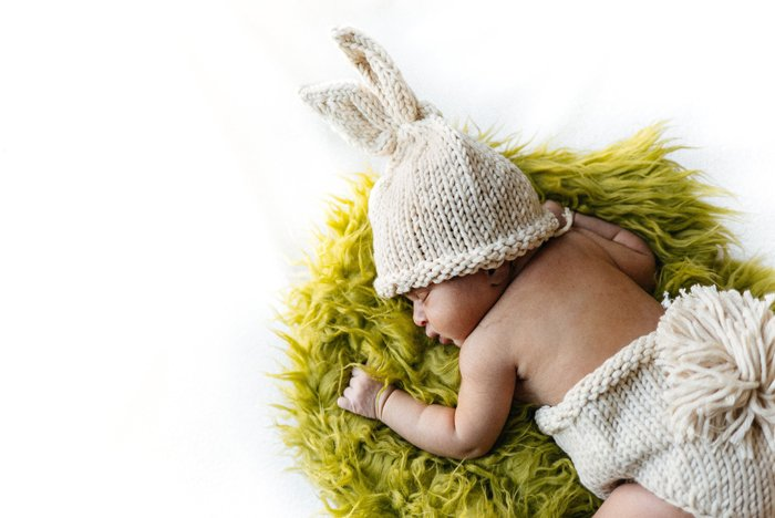 photo of a newborn baby in an Easter bunny outfit