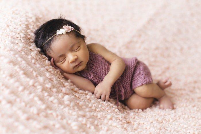 photo of a newborn with a cute headband