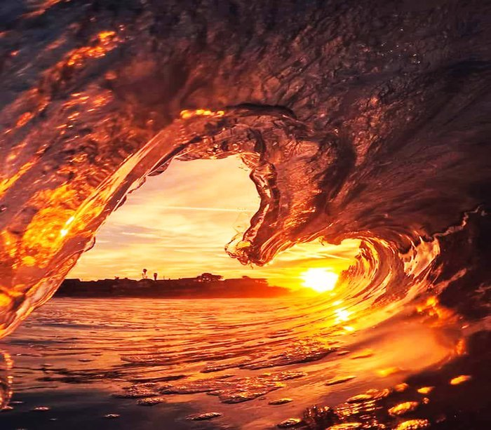 Cool seascape shot through a wave at sunset