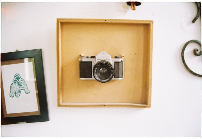 Flat lay of a vintage camera and picture frames