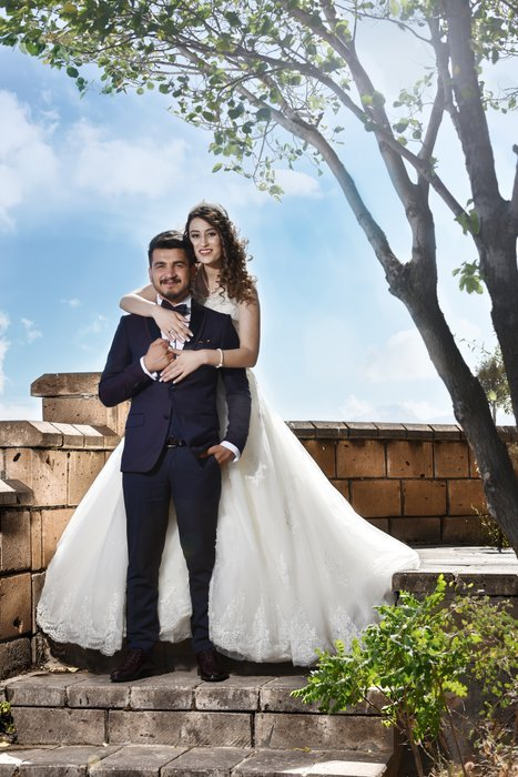 A bride and groom posing outdoors