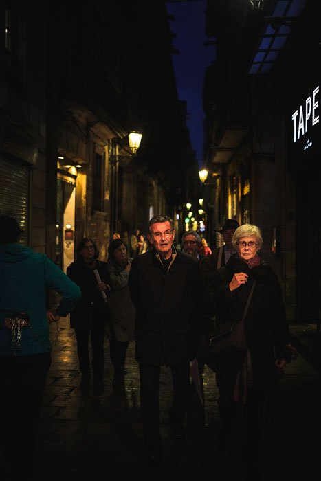 People walking through busy streets at night