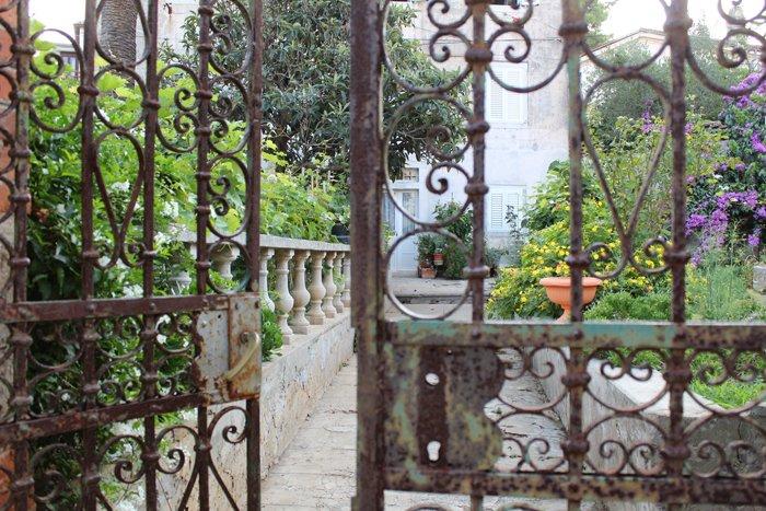 an image of a garden through an iron gate shot with a Canon 1300D