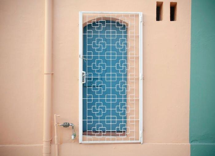 photo of a blue window with asymmetrical balance