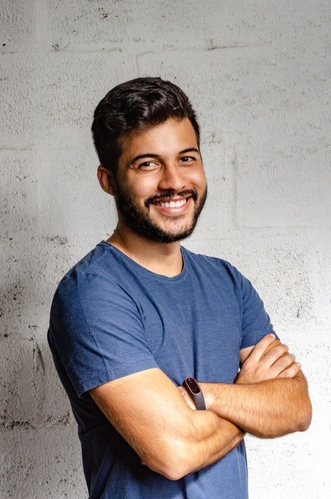 A smiling man posed for a headshot