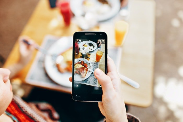 A smartphone being used to capture food photography