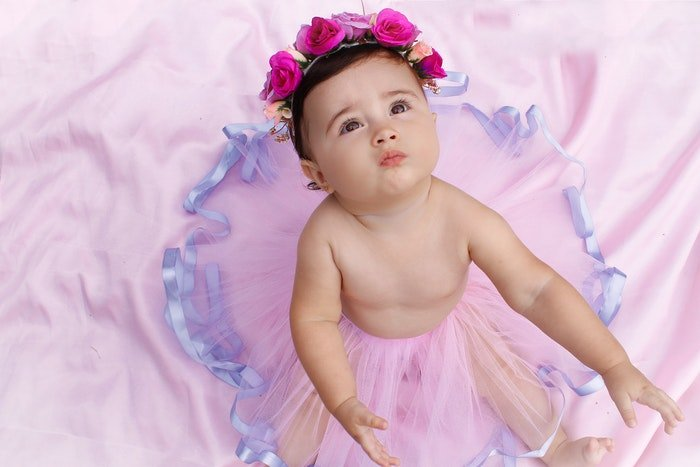 Sweet baby in flower wreath and tutu