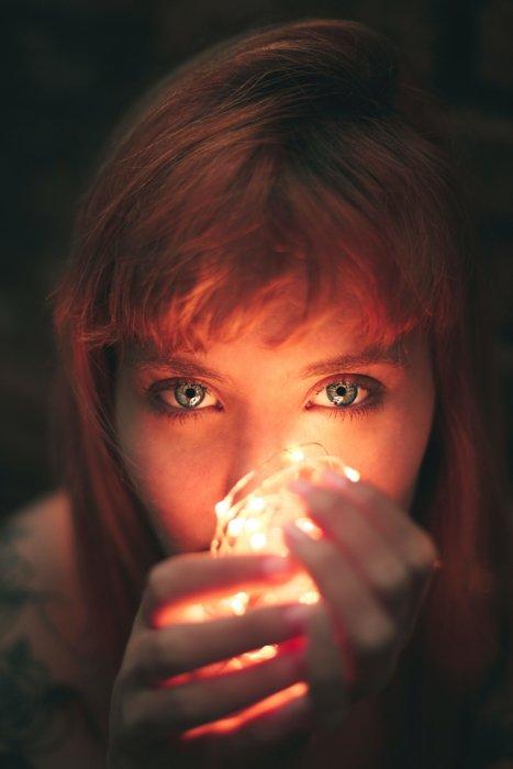Closeup of a female model holding fairy lights