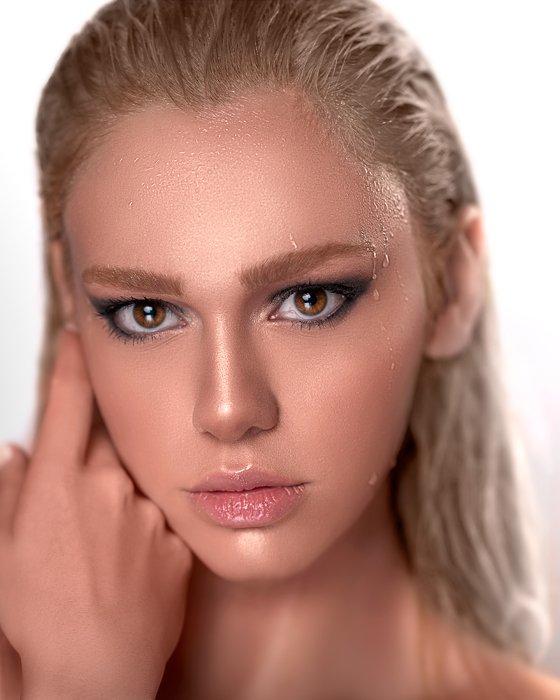 A close up portrait of a beautiful blonde girl