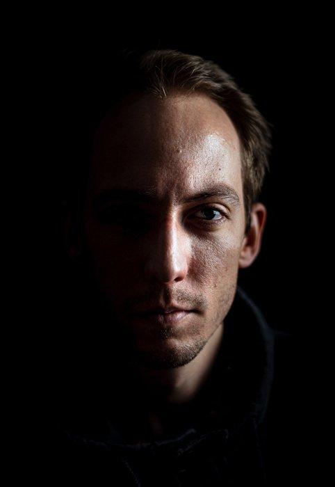 A shadowy portrait of a man