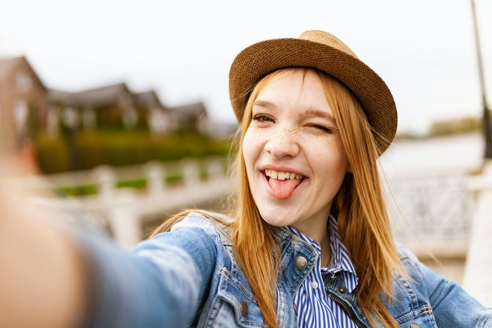 A girl taking a selfie outdoors