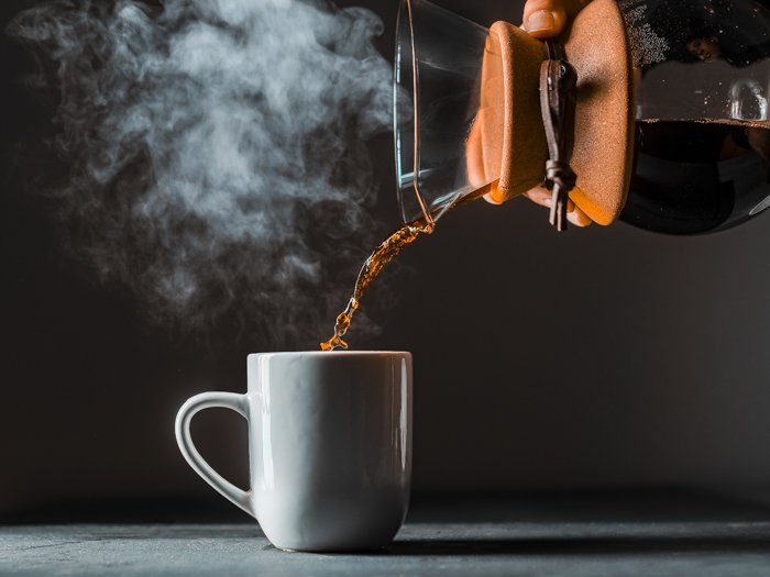 Pouring a cup of steaming coffee