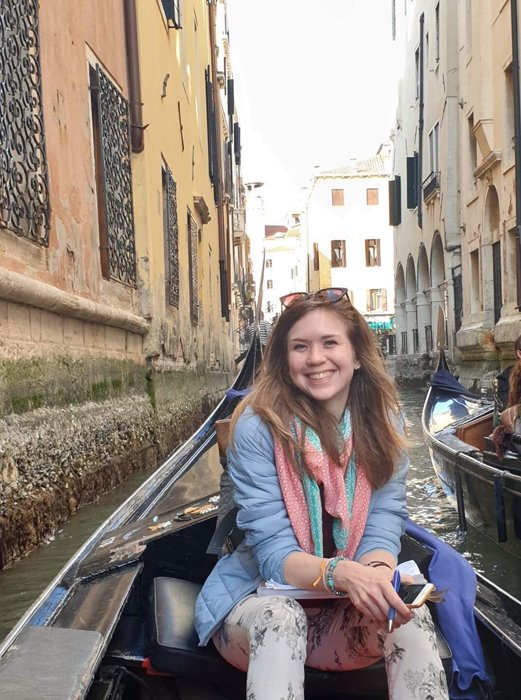 A smiling girl on a gondola in Venice