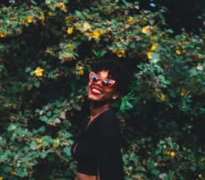 A social media profile photo of a woman in sunglasses