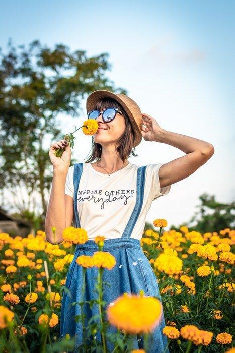 A girl in a field of flowers