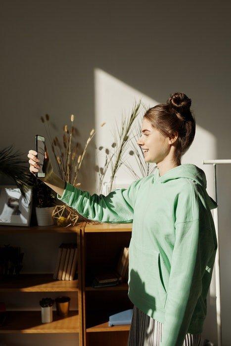 A girl taking a self portrait