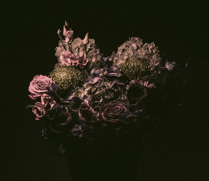 still life photo of a bouquet of pink flowers