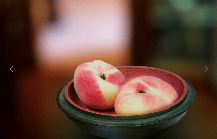 Contemporary still lifes photo of peaches in a bowl