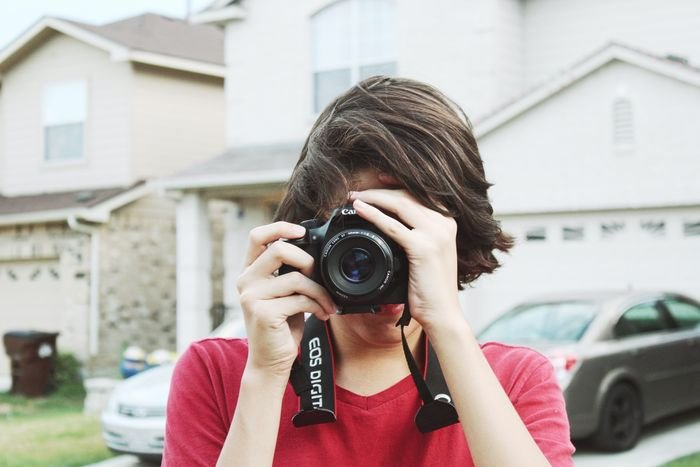 photo of a guy taking a photo with a dslr camera