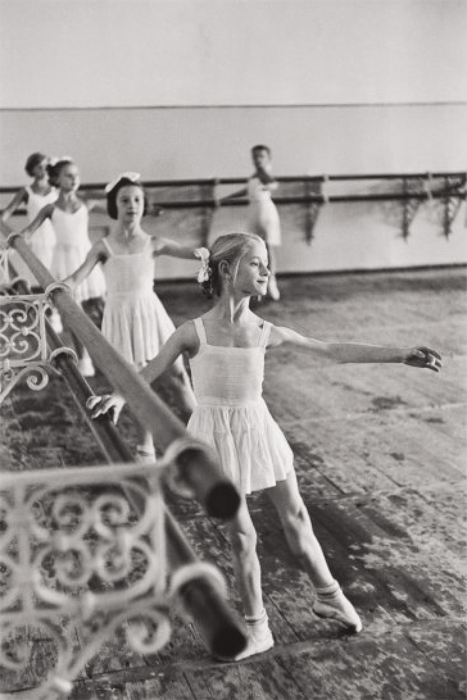 a black and white henri-cartier bresson image of 5 dancers at the bolshoi ballet school