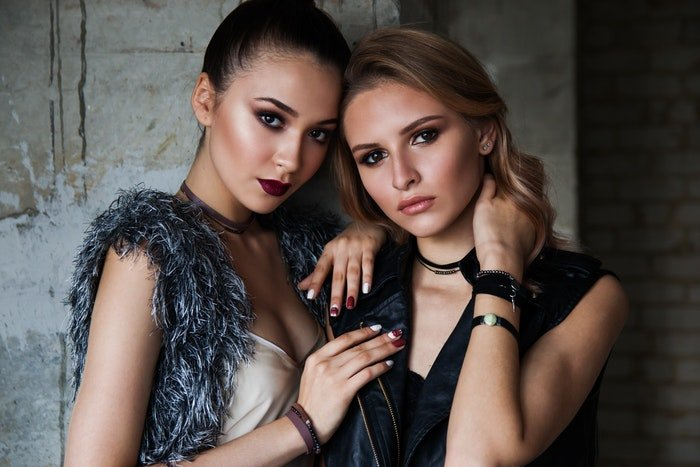 Two female models posing for a fashion shoot