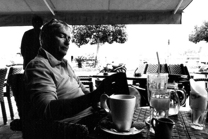 Black and white lifestyle photo of a man having coffee