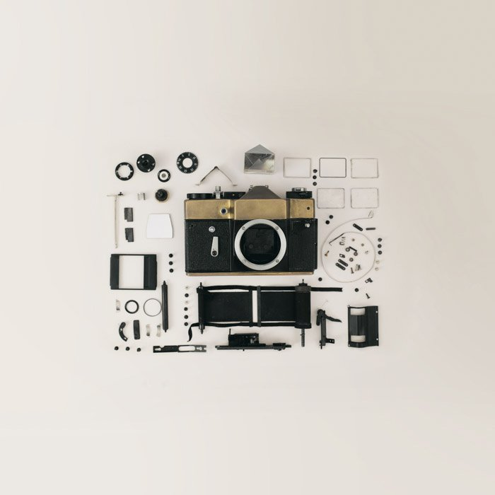 Flay lay photo of film camera and gear
