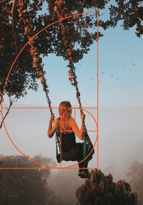 A photo of a girl on a swing overlayed with golden ratio composition grid