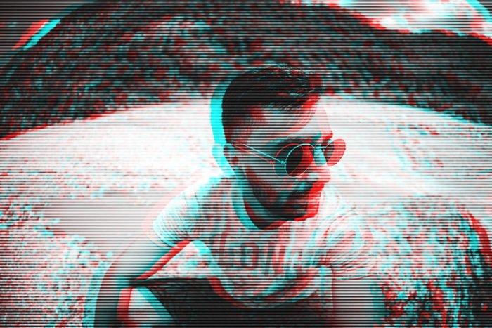 Glitch effect photo of a man in sunglasses