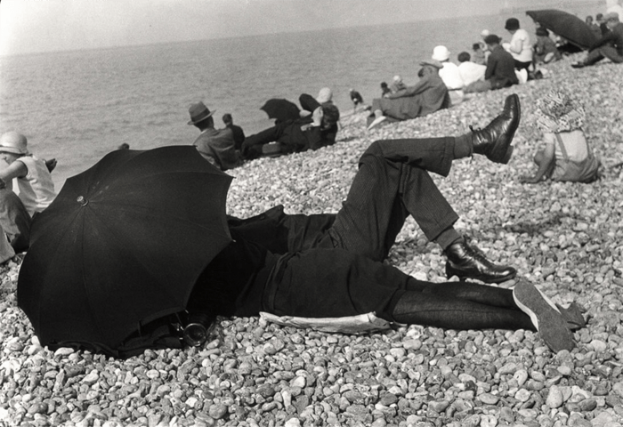 Henri Cartier-Bresson image of a man and woman under an umbrella on a beach
