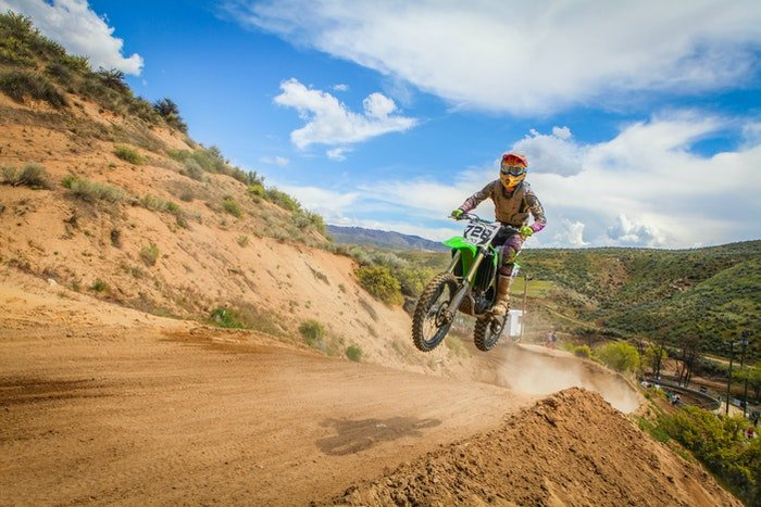 Dirt bike in motion with plenty of lead room ahead helps convey the sense of motion