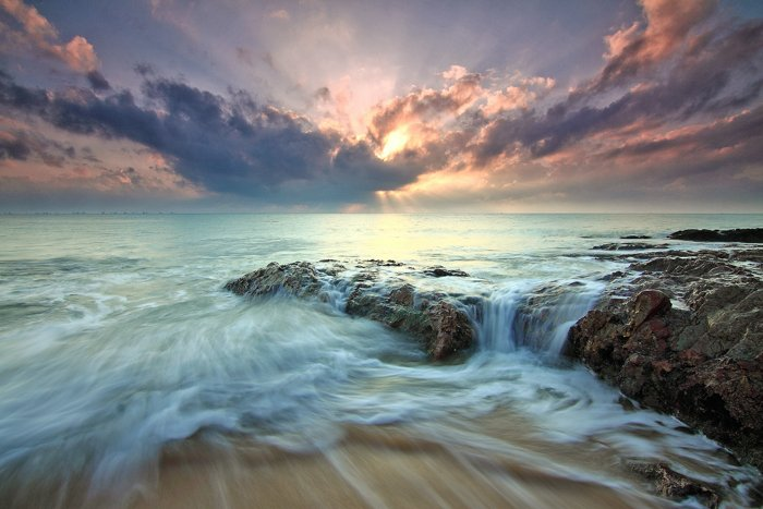 long exposure photo of the sea at sunrise